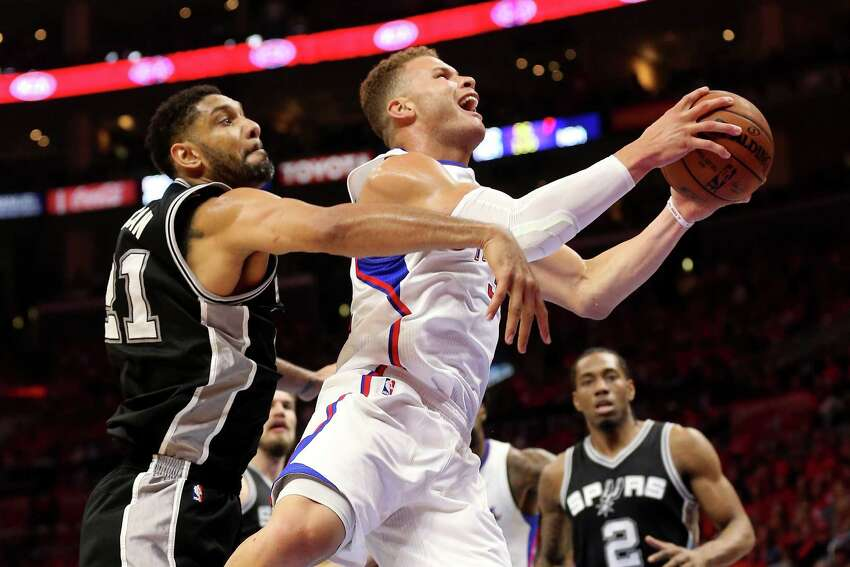 LOS ANGELES, CA - APRIL 19: Blake Griffin #32 of the Los Angeles Clippers goes up for a shot against Tim Undcan #21 of the San Antonio Spurs during Game One of the Western Conference quarterfinals of the 2015 NBA Playoffs at Staples Center on April 19, 2015 in Los Angeles, California. NOTE TO USER: User expressly acknowledges and agrees that, by downloading and or using this photograph, User is consenting to the terms and conditions of the Getty Images License Agreement.