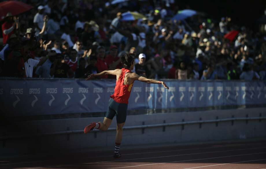Gowei Zhang, of China, celebrates after winning the men's high jump at the Mount SAC Relays track and field meet at Mt. San Antonio College, Saturday, April 18, 2015, in Walnut, Calif. (AP Photo/Jae C. Hong) Photo: Jae C. Hong, Associated Press