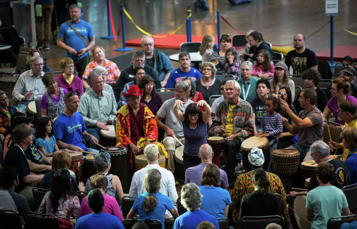 A participant takes the lead during the Great Northwest Drum Circle closing ceremony for the 22nd Annual World Rhythm Festival. Each year the three day festival brings hundreds to the Seattle Center for dance workshops, drum circles and music performances from around the world. Photographed Sunday, April 19, 2015.