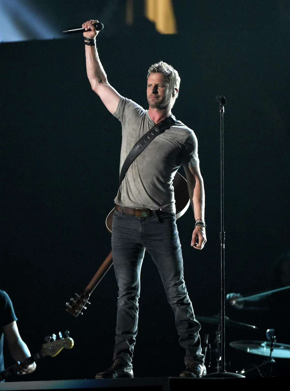 Dierks Bentley performs at the 50th annual Academy of Country Music Awards at AT&T Stadium on Sunday, April 19, 2015, in Arlington, Texas. (Photo by Chris Pizzello/Invision/AP) ORG XMIT: TXBR212