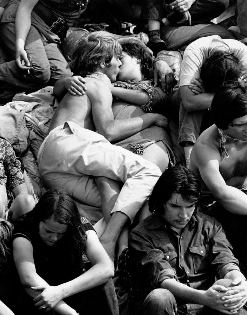 A couple kissing in the crowd at the Isle of Wight Pop Festival.