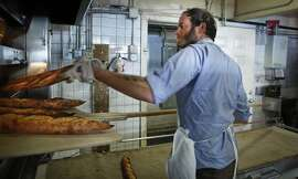 Chad Robertson of Tartine Bakery and Cafe checks baking bread on Friday, Sept. 14, 2014 in San Francisco, Calif.