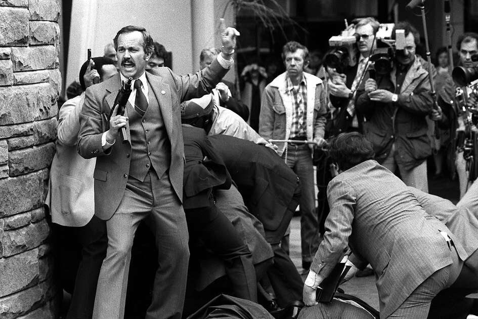 John Hinckley is wrestled to the ground in this March 30, 1981 file photo after he slipped in behind cameramen, fired his weapon between them, hitting President Ronald Reagan, Officer Delahanty, and  Secret Service Agent Tim McCarthy.
