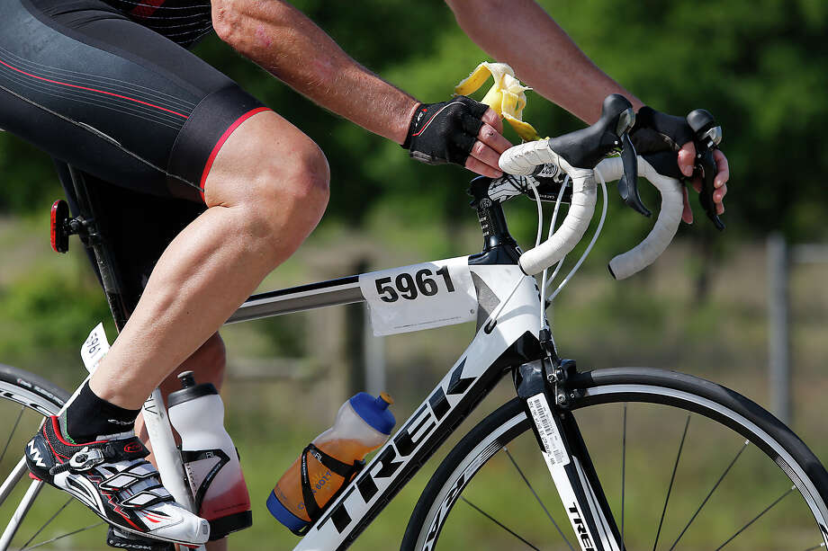 Smart cycling: Gregory Bilhartz snacks on a banana as he makes his way through the foothills along FM 969 on the edge of Austin Sunday during the BP MS 150. Photo: Ralph Barrera / AustinStatesman