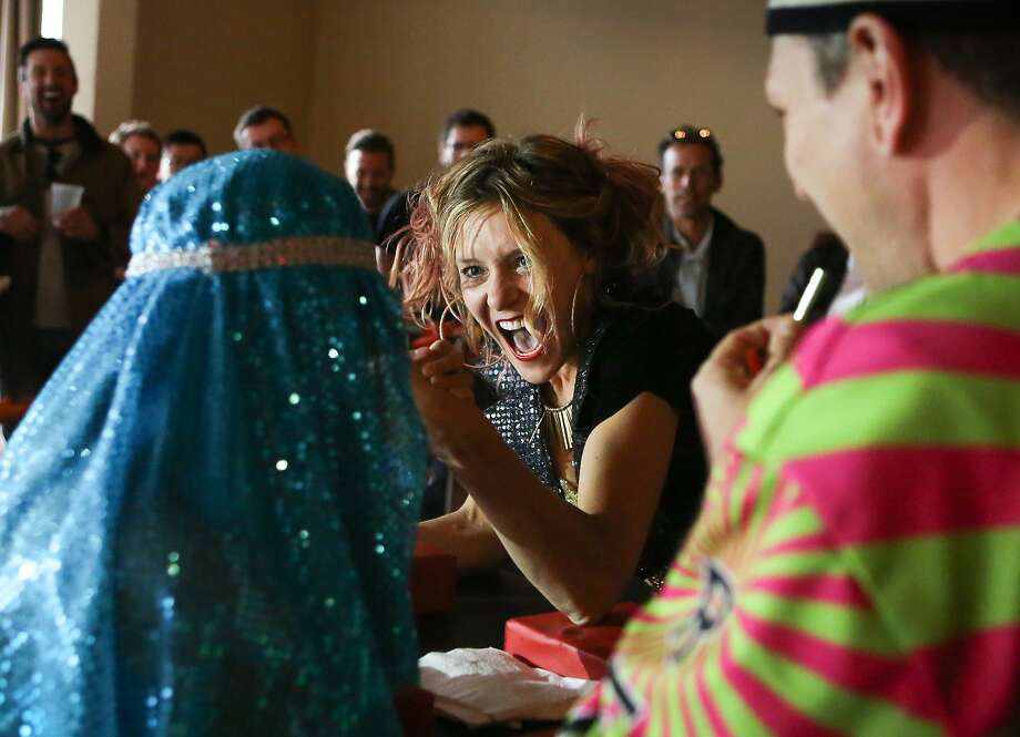 Rachel Znerold gets into her match at the 5th Annual Ladies Arm Wrestling Tournament: Disco Edition in San Francisco, Calif., on Sunday, April 19, 2015. Photo: Amy Osborne, The Chronicle