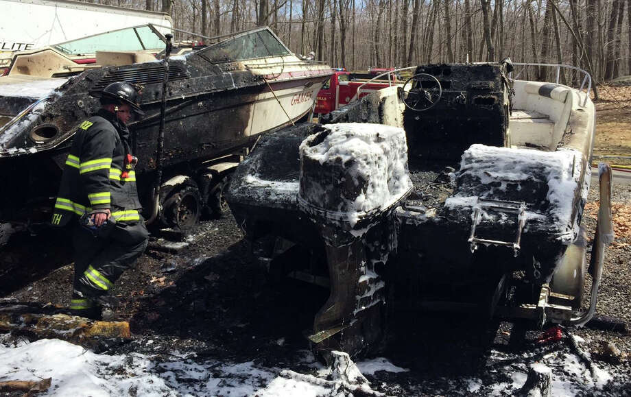 Stevenson, Monroe and Stepney volunteer firefighters responded last week to a Webb Circle residence for a fast-moving brush fire, in Monroe, Conn., on Apr. 16, 2015. According to Fire Marshal Bill Davin, the resident had been burning a small pile of sticks when the fire quickly escalated, spreading to two boats and trailers, a box truck and a large section of woods. Photo: Contributed Photo / Connecticut Post Contributed