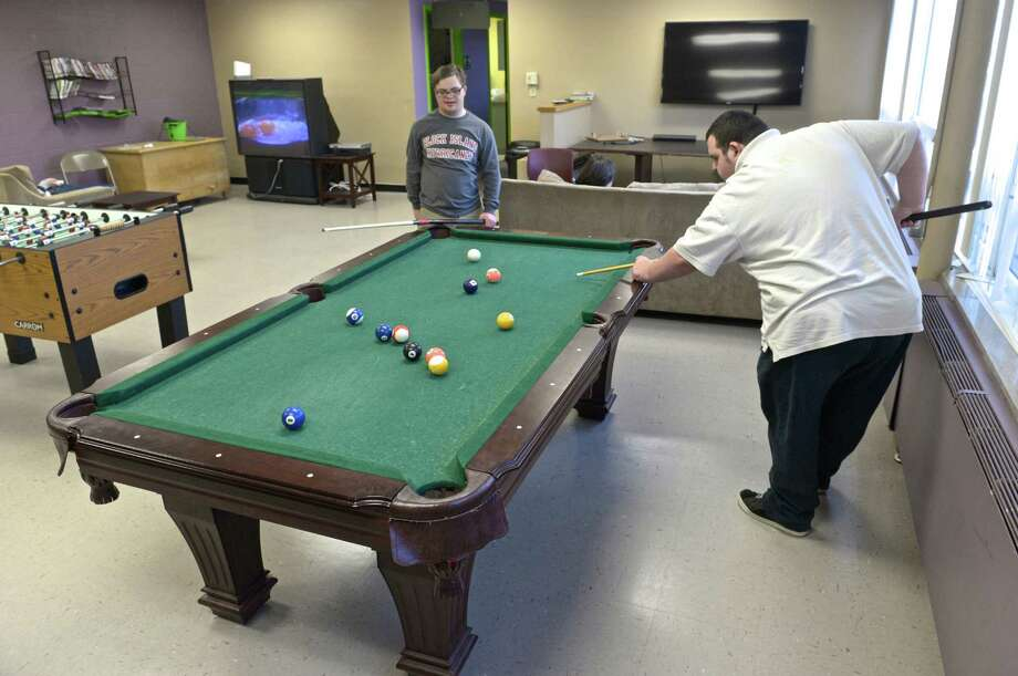 Bradley Smith, 18, right, and Jack Johnson, 18, both from Bethel, play pool in the game room of the Bethel teen center,  Pro Access. Photo: H John Voorhees III / The News-Times