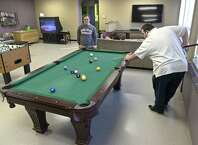 Bradley Smith, 18, right, and Jack Johnson, 18, both from Bethel, play pool in the game room of the Bethel teen center,  Pro Access.