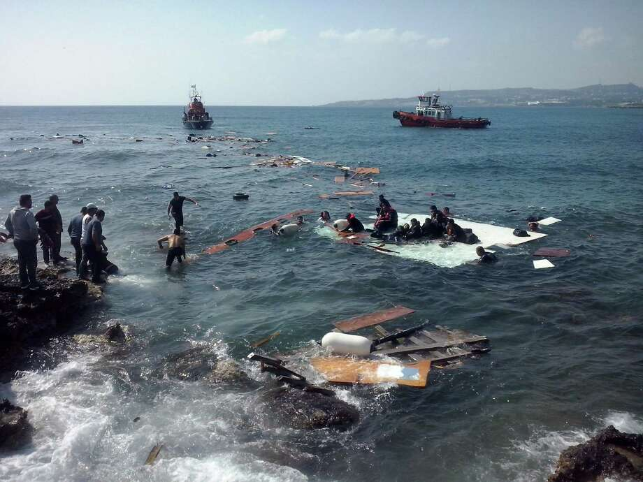 Men help survivors of a vessel that sank off the Greek island of Rhodes. Three people were feared dead. Photo: Xinhua / McClatchy-Tribune News Service / Zuma Press