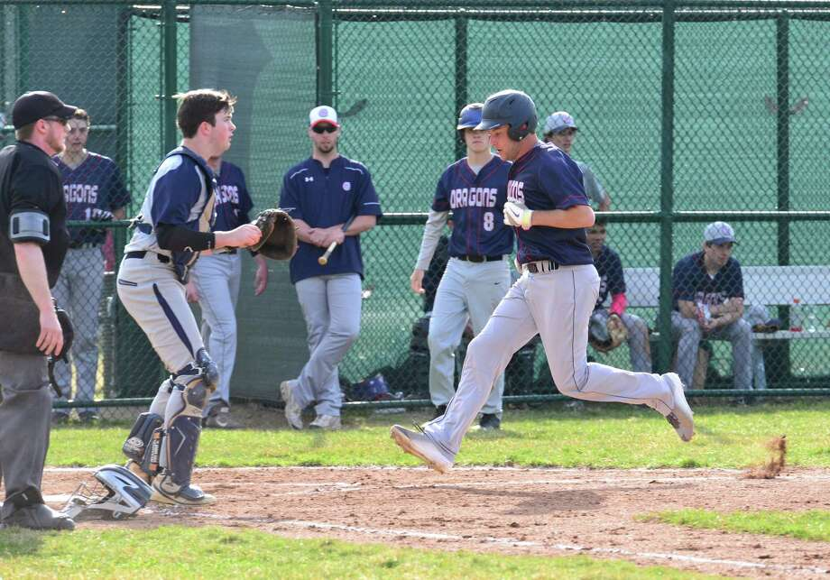 Senior Jake Berman (Westport) scores for the Dragons in the team's 10-3 loss to Rye Country Day School on Wednesday, April 15. Photo: Contributed Photo / Westport News Contributed