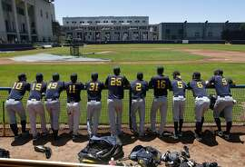 Cal Bears baseball players wait for a workout to start in the dugout at Evans Diamond in Berkeley, Calif. on Tuesday, June 14, 2011, in preparation for their College World Series appearance.