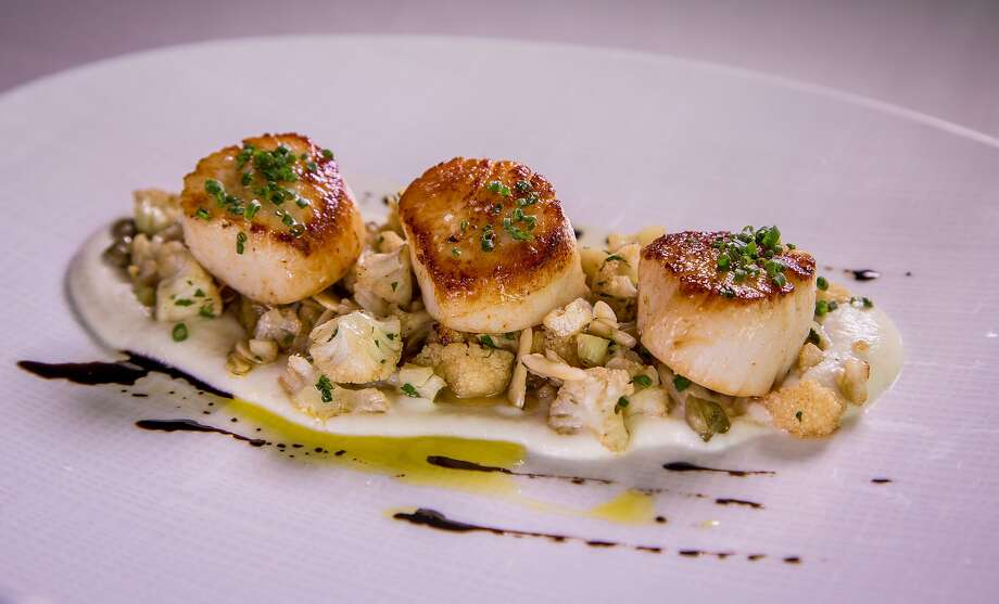 Caramelized Diver Scallops with Cauliflower, toasted Barley and wild Mushrooms at Redd in Yountville, Calif., is seen on March 22nd, 2015. Photo: John Storey, Special To The Chronicle