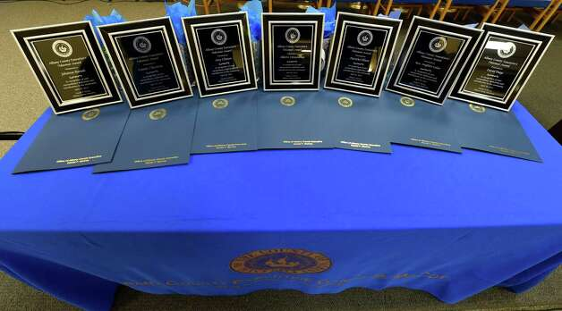 Seven plaques were to be awarded to outstanding volunteers show helped veterans, senior and the community during the Albany County Executive's Volunteer of the Year awards ceremony held Monday morning April 20, 2015 at the Albany County Office Building in Albany, N.Y.    (Skip Dickstein/Times Union) Photo: SKIP DICKSTEIN / 00031529A