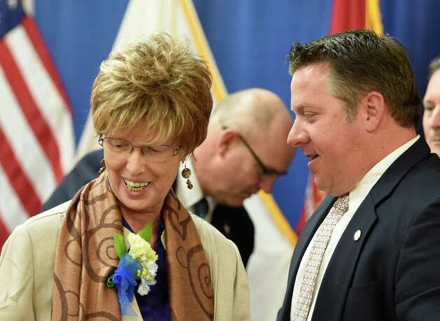 Johanna Baniak of Watervliet is greeted by Albany County Executive Dan McCoy, right, after giving her acceptance speech as one of the outstanding volunteers during the Albany County Executive's Volunteer of the Year awards ceremony held Monday morning April 20, 2015 at the Albany County Office Building in Albany, N.Y.    (Skip Dickstein/Times Union) Photo: SKIP DICKSTEIN / 00031529A
