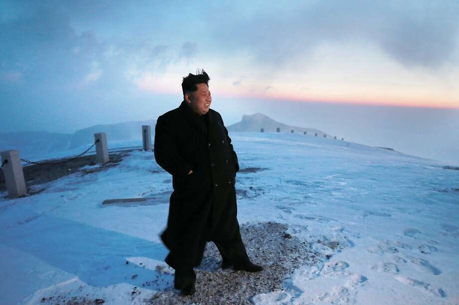 A photo released by North Korea's official Korean Central News Agency on April 20, 2015, shows North Korean leader Kim Jong-Un on snow-covered Mount Paektu at sunrise. Photo: Kns, AFP / Getty Images