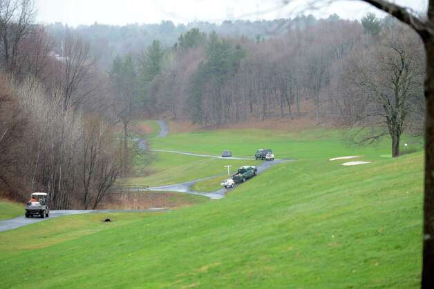 Equipment is driven into Capital Hills golf course to tackle a mudslide along Normans Kill that caused water to back up to the west Monday afternoon, April 20, 2015, in Albany, N.Y. (Will Waldron / Times Union) Photo: WW