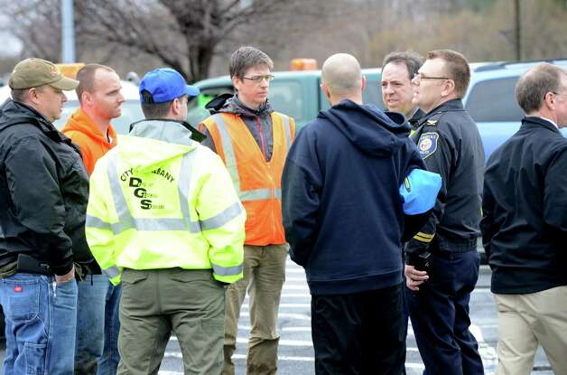 Officials gathered at Capital Hills golf course to tackle a mudslide along Normans Kill that caused water to back up to the west Monday afternoon, April 20, 2015, in Albany, N.Y. (Will Waldron / Times Union) Photo: WW