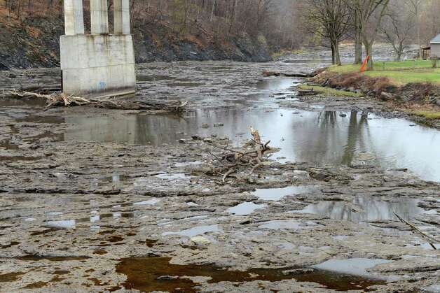Water virtually stopped flowing east of the Normans Kill blockage as seen under Delaware Ave. Monday afternoon, April 20, 2015, at the border of Delmar and Albany, N.Y. (Will Waldron / Times Union) Photo: WW