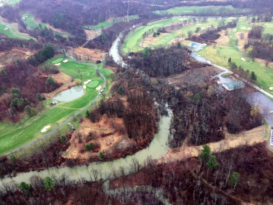 Arial view of the Normans Kill between Capital Hills Golf Course, left, and Normans Side Country Club, right where a mudslide originating from Normans Side blocked the Normans Kill. (State Police) Photo: WW