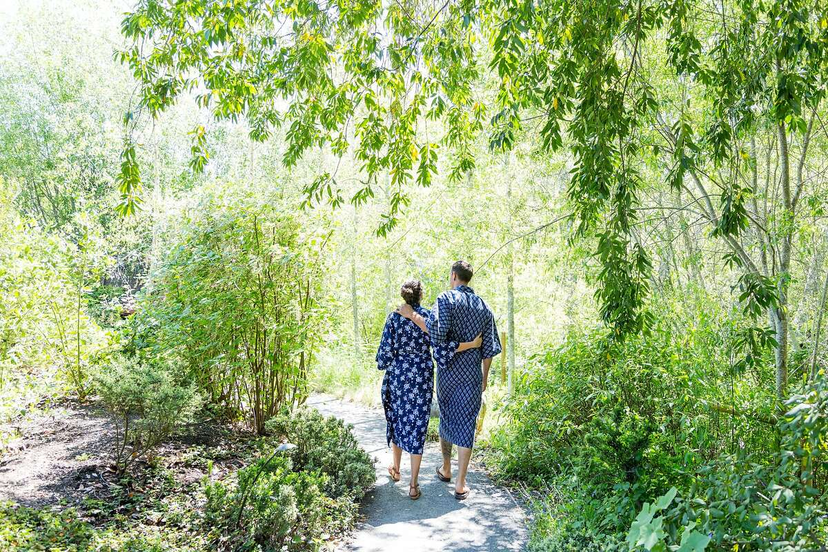 Rene and Jason Robinson leaving the meditation garden at Osmosis Day Spa in Freestone, Calif., Friday, April 17, 2015. The spa serves boxed lunches from neighboring restaurant Fork.