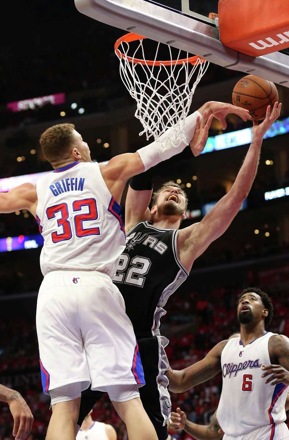 The Spurs' Tiago Splitter shoots over the Clippers' Blake Griffin during Game 1 on Sunday.