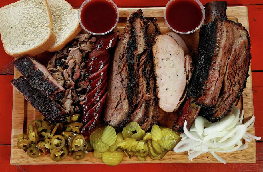 A display of barbecue including ribs, jalapeno sausage, turkey and beef rib at Roegels Barbecue Co. on Voss. Photo: Karen Warren, Staff / © 2015 Houston Chronicle