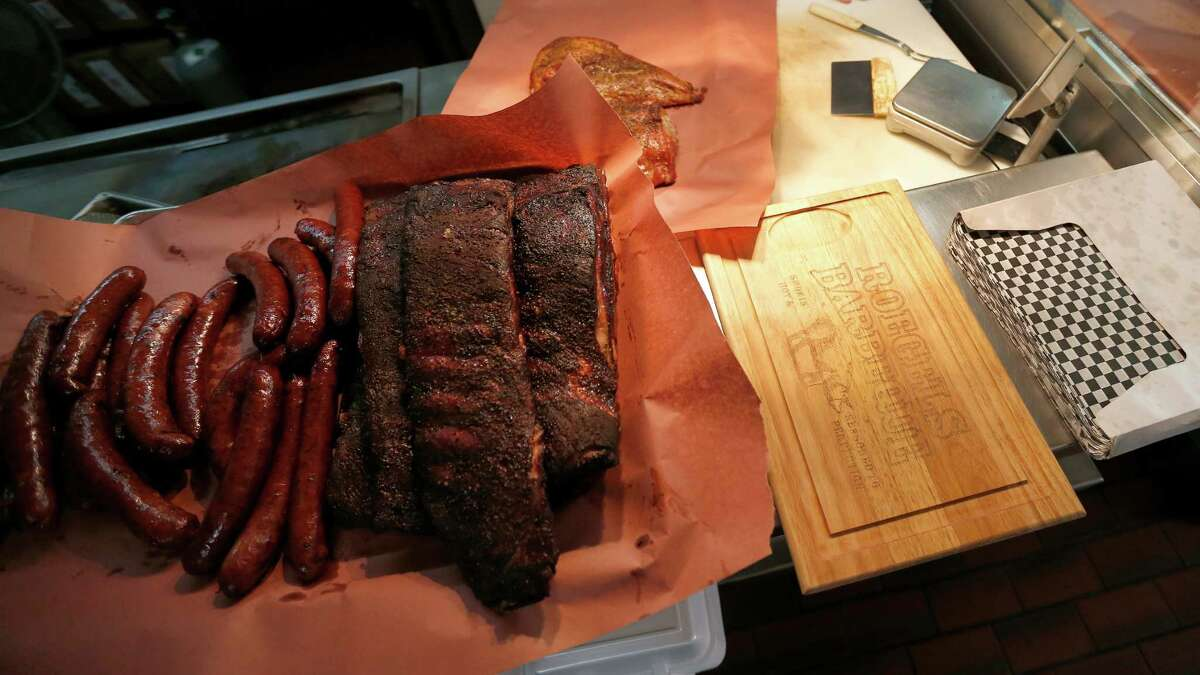 Ribs and sausage wait to be cut up at Roegels Barbecue Co. on Voss, Thursday, April 16, 2015, in Houston. ( Karen Warren / Houston Chronicle )
