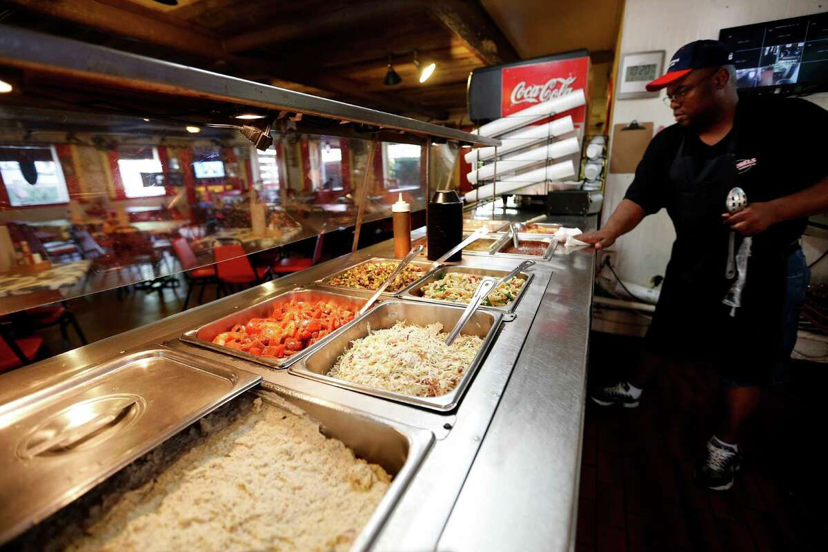 The counter filled with sides at Roegels Barbecue Co. on Voss, Thursday, April 16, 2015, in Houston. ( Karen Warren / Houston Chronicle )