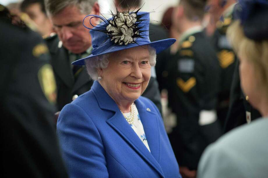 Britain's Queen Elizabeth II meets guests during a reception for Canadian regiments and decendents who fought in WWI battles at Canada House in central London on April 19, 2015. The event marked the centenary of World War 1 battles involving three Canadian regiments. AFP PHOTO / POOL / LEON NEALLEON NEAL/AFP/Getty Images Photo: LEON NEAL / AFP