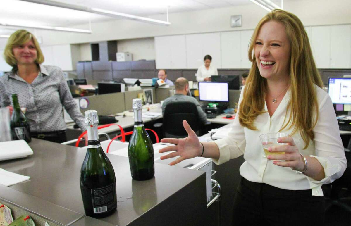 (left) Houston Chronicle editor and executive vice president of news Nancy Barnes smiles as Houston Chronicle Columnist Lisa Falkenberg addresses the Houston Chronicle news room after finding she has won the 2015 Pulitzer Prize for Commentary, the Pulitzer board announced Monday April 20, 2015. This is the first Pulitzer Prize awarded to the Chronicle in its 114-year history.