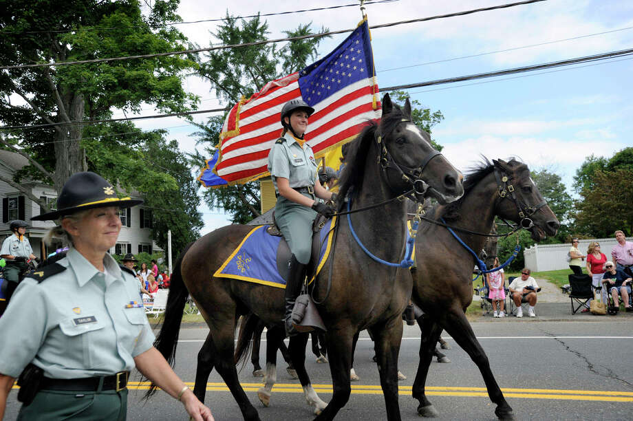 The 2nd Company Governor's Horse Guard marches in the 2012 Newtown Labor Day Parade Sept. 2012. Photo: Carol Kaliff / The News-Times