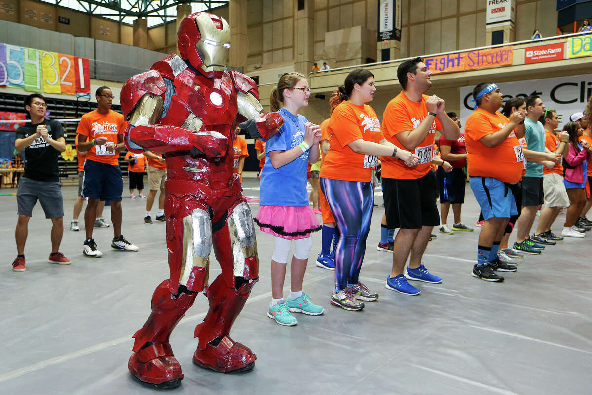Albert Lee (from front left), in one of his Iron Man costumes, dances with Riley Teske, 11, Caitlyn Silvas, 24, Carl Myers, 25, Andly Linares, 27, and others during a twelve hour dance marathon at the UTSA Convocation Center on Saturday, April 11, 2015. For The Kids, a UTSA student group that helps children with cancer and their families, sponsored the event. MARVIN PFEIFFER/ mpfeiffer@express-news.net