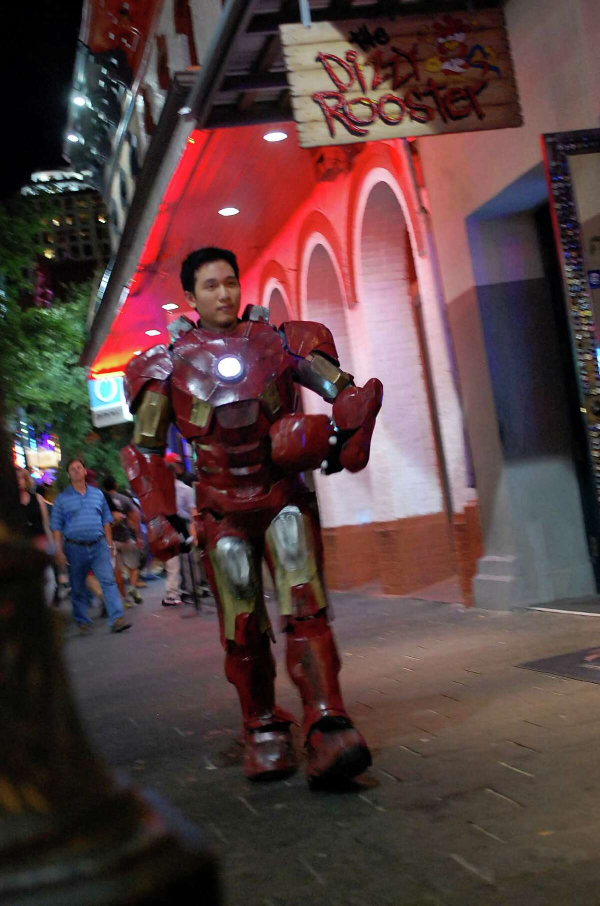 Albert Lee, a Junior at the University of Texas at San Antonio, wearing an Iron Man suit he made to help campus group, For the Kids, raise funds for children with cancer.