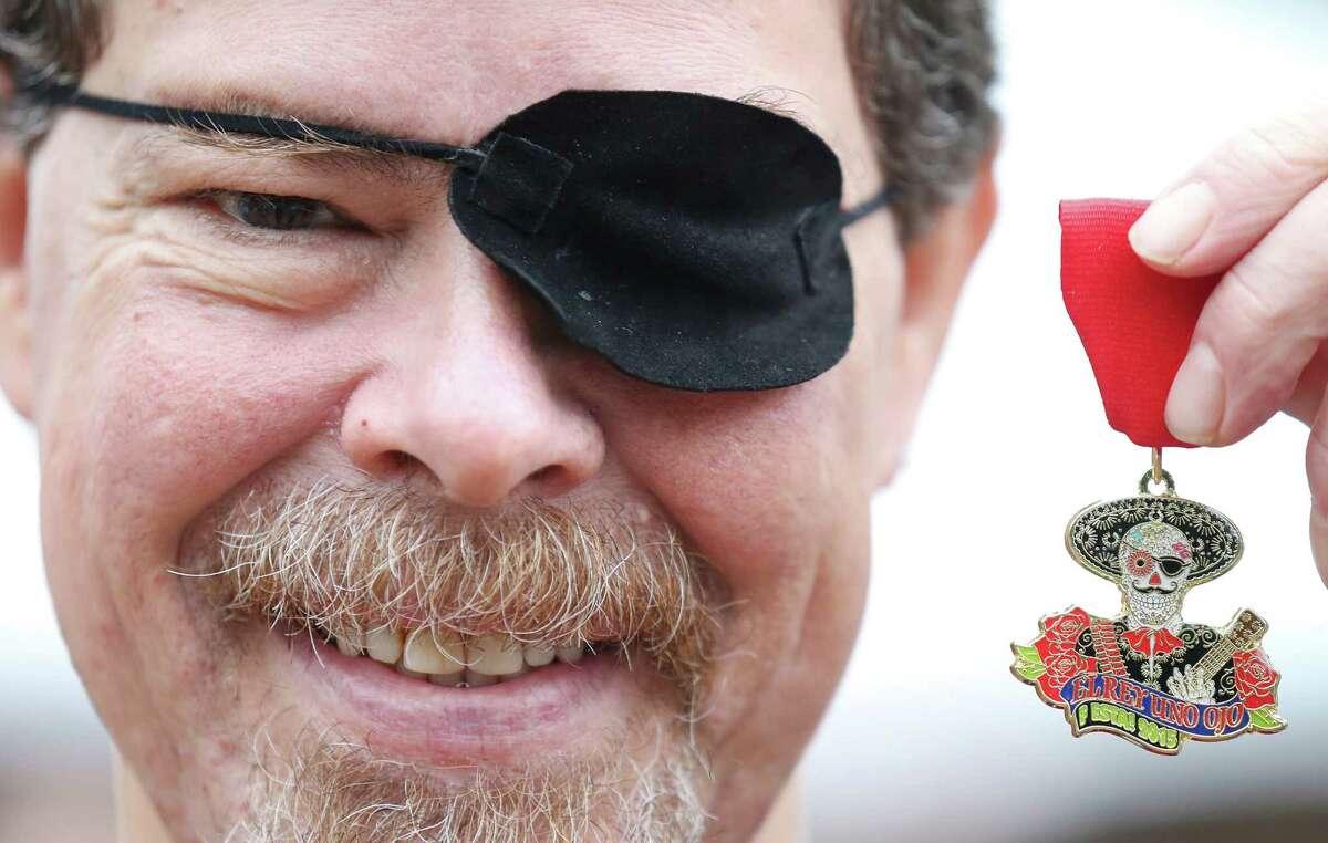 "Phil Darrah shows his 2015 Fiesta medal ""El Rey Uno Ojo"" at the Fiesta Fiesta event at the Alamo April 16."