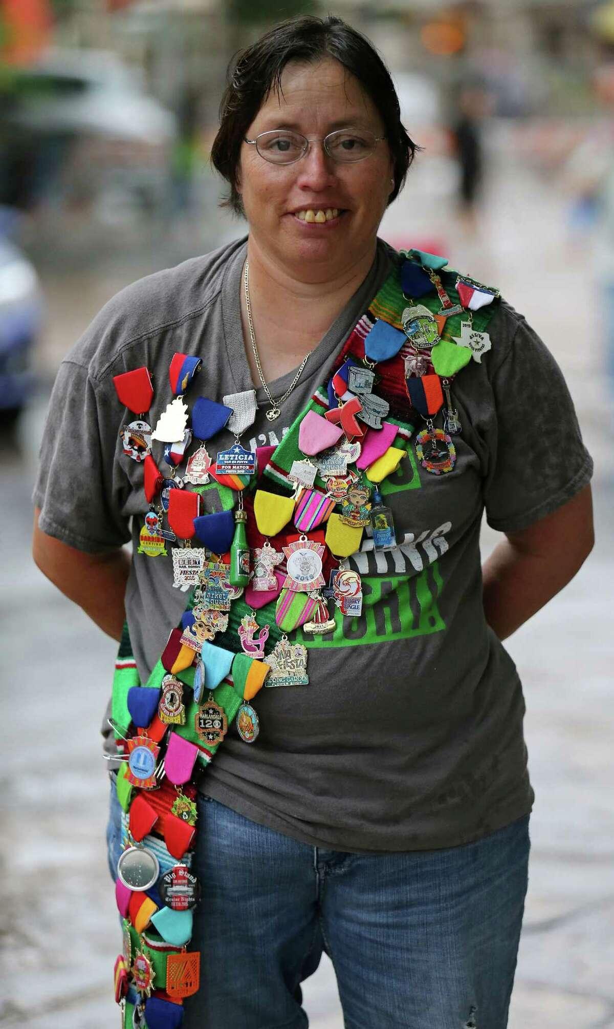 Diana Honesto wears her Fiesta medals at Pin Pandemonium, part of the Fiesta Fiesta at the Alamo April, 16