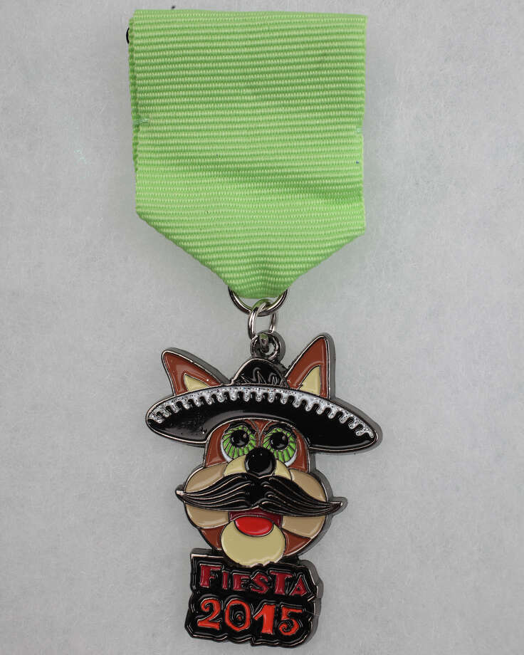 The Spurs Coyote is out front on the 2015 Silver & Black Give Back Fiesta Medal. The $10 medal has been sold at San Antonio Spurs' home games since March 20. All proceeds will go to the nonprofit organization's youth programs such as Team Up Challenge and the Spurs Youth Basketball League. Photo: Juanito Garza /San Antonio Express-News / San Antonio Express-News