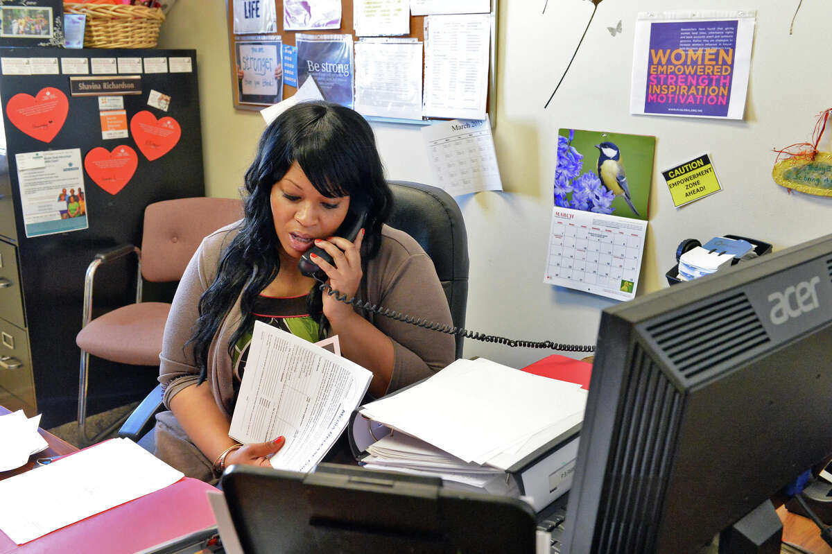 Client advocate Shavina Richardson in her office at St. Paul's Center on 3rd Street Thursday March 19, 2015 in Rensselaer, NY.