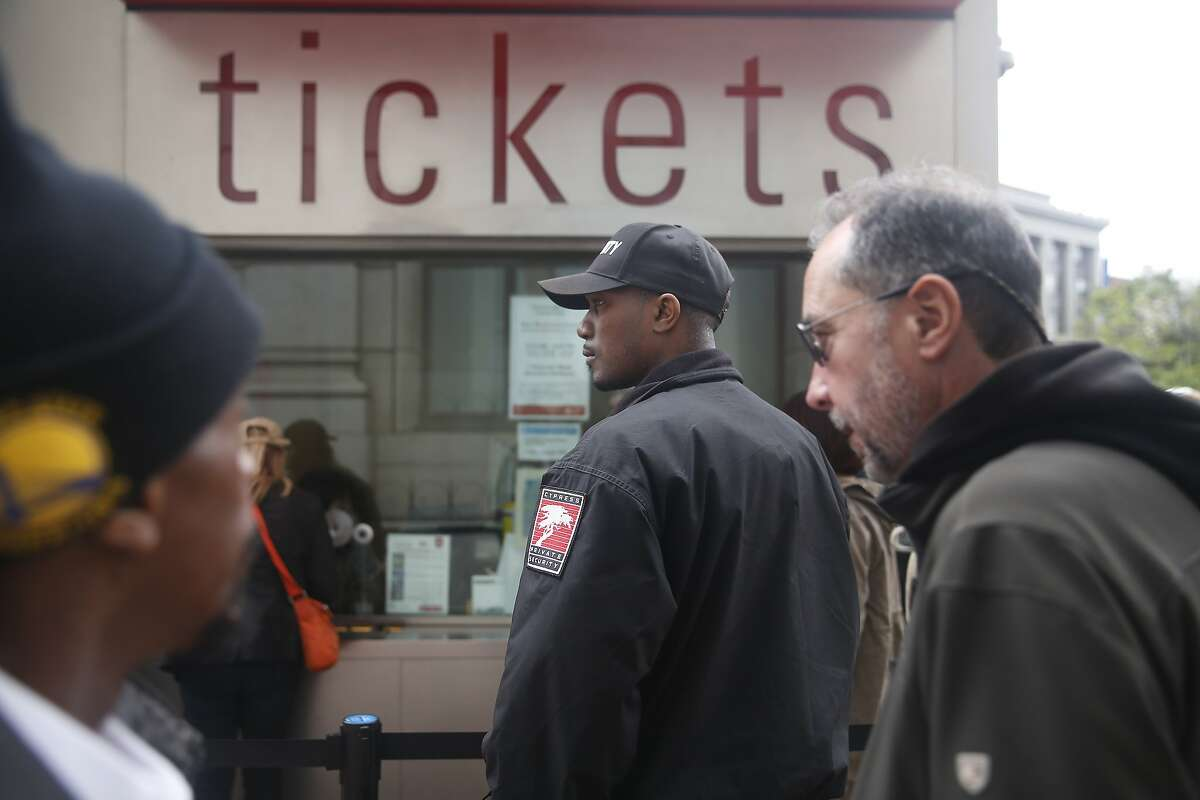 Kasayle Howard (center), armed security guard with Cypress Security, stands next to the cable car fare kiosk while working at Powell and Market Streets on Monday, April 20, 2015 in San Francisco, Calif.