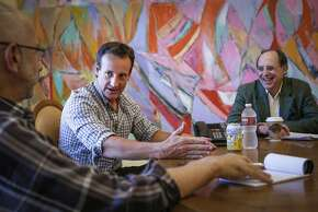 Todd Traina, center, makes a point during a meeting with Russell Levine, left, and Spencer Tandy on Thursday, April 16, 2015 in San Francisco, Calif.