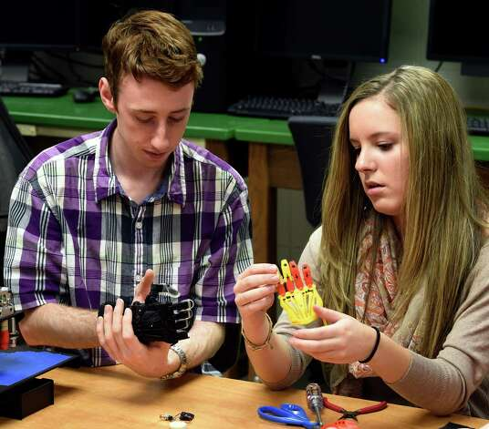 Jack Rogers Jr.. left and Alyx Gleason work on the prototype of a prosthetic hand for 5 year old Jack Carter of Columbus Ohio Monday afternoon April 20, 2015 at Siena College in Loudonville, N.Y.      (Skip Dickstein/Times Union) Photo: SKIP DICKSTEIN / 00031532A
