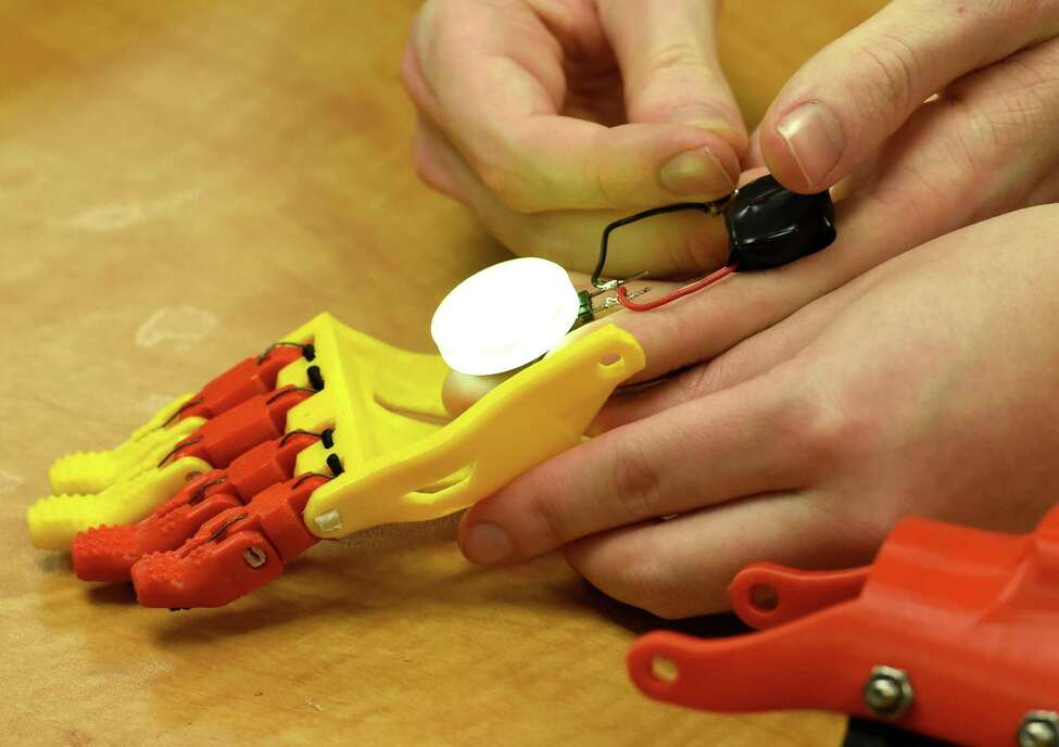 Jack Rogers Jr.. left and Alyx Gleason work on the prototype of a prosthetic hand for 5 year old Jack Carter of Columbus Ohio Monday afternoon April 20, 2015 at Siena College in Loudonville, N.Y. (Skip Dickstein/Times Union)