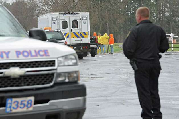 A police officer blocks traffic from entering the Capital Hills at Albany golf course because construction crew needed to unload piping to pump out flood water due to a mudslide in the Norman Kill on Monday, April 20, 2015 in Albany, N.Y. (Lori Van Buren / Times Union) Photo: Lori Van Buren