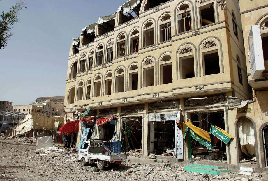 A street is littered with debris after a Saudi-led airstrike against Shiite rebels, known as Houthis, hit a weapons cache Monday in Sanaa, Yemen. At least 19 people died in the explosions and scores more were buried in rubble. Photo: Hani Mohammed, STR / AP
