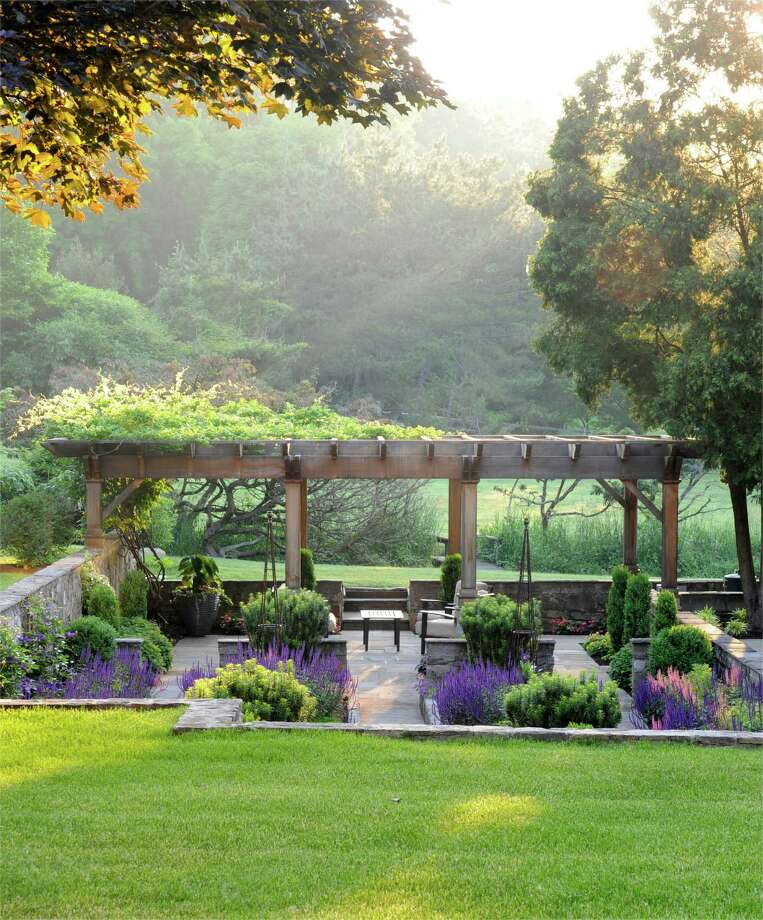 "A sunken stone patio with pergola are the highlights of one garden featured in ""Gardens At First Light,"" a photography/landscaping book by Westporter Stacy Bass that will be published on May 5. Photo: Contributed Photo / Connecticut Post Contributed"