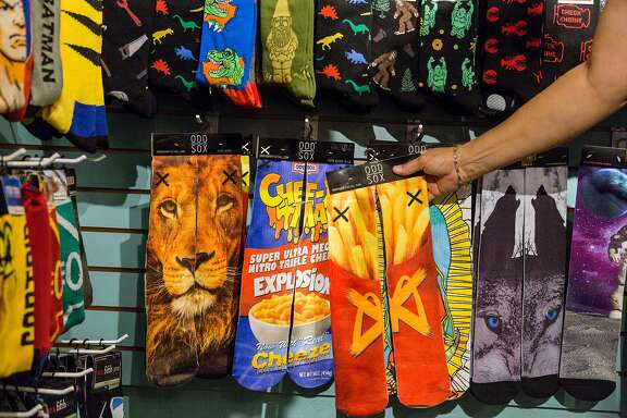 A variety of socks printed with sublimation such as french fries, a lion, and a faux mac and cheese box at Sox de Vine, a specialty sock store in Sonoma, Calif., Saturday, April 18, 2015.