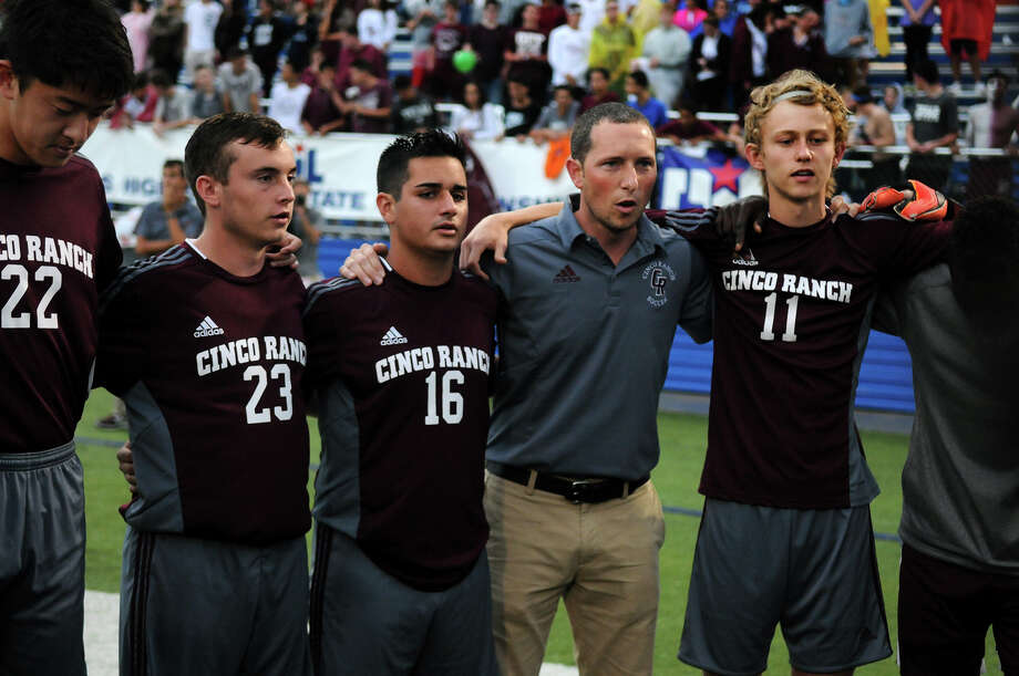 Cinco Ranch head boys soccer coach Mason Whitfield, center, pumps up his team, including Hiromu Aikawa, from left, Lyle Tiernay, Vasco Conroy, and Charlie Sorg before the start of their  UIL Soccer State Championship semifinal match versus Arlington Houston at Birkelbach Field in Georgetown on Friday, April 17, 2015. Photo: Jerry Baker, Freelance