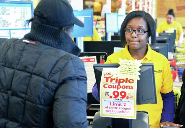 Cashier Brianna Duhhan, right, with a customer at ShopRite on Central Avenue Tuesday March 31, 2015 in (John Carl D'Annibale / Times Union) Photo: John Carl D'Annibale / Albany, NY.