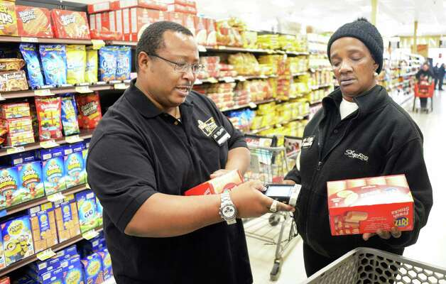 Shop from home clerks Dell Foulks, left, and Robin Jones fill an order at ShopRite on Central Avenue Tuesday March 31, 2015 in (John Carl D'Annibale / Times Union) Photo: John Carl D'Annibale / Albany, NY.