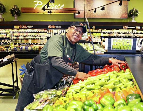 Produce associate Jim Smith stocks fresh vegetables at ShopRite on Central Avenue Tuesday March 31, 2015 in (John Carl D'Annibale / Times Union) Photo: John Carl D'Annibale / Albany, NY.