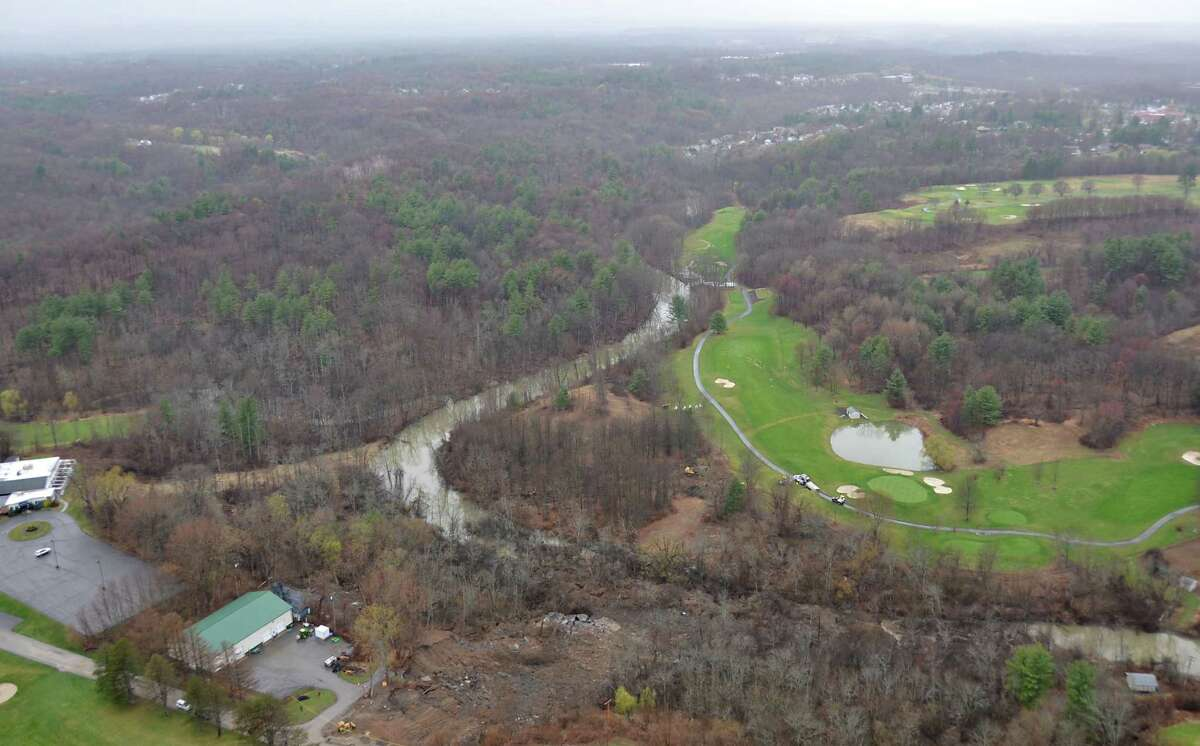 View from a state police helicopter of the mudslide into the Normans Kill on Monday, April 20, 2015 in Delmar, N.Y. The Normanside Country Club is seen at left. Capital Hills at Albany is seen at right. (New York State Police)